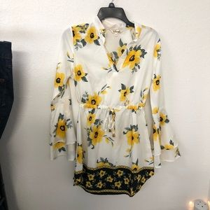 Small boutique floral dress with bell sleeves
